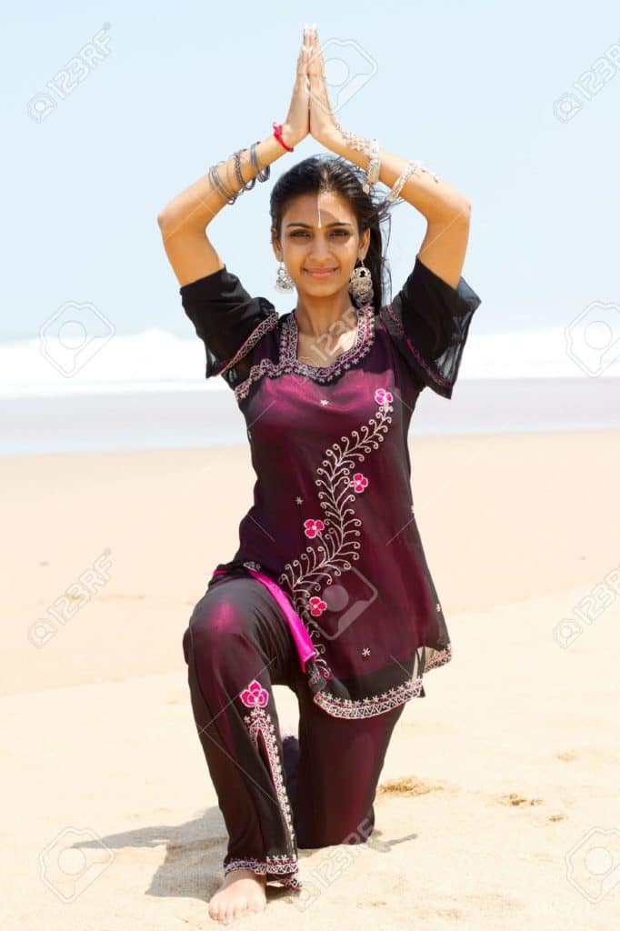 9119211-indian-woman-doing-yoga-on-beach-Stock-Photo