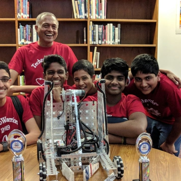 TechnoWarriors 2018 with Robot and trophies2