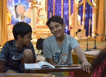 Students learning in temple